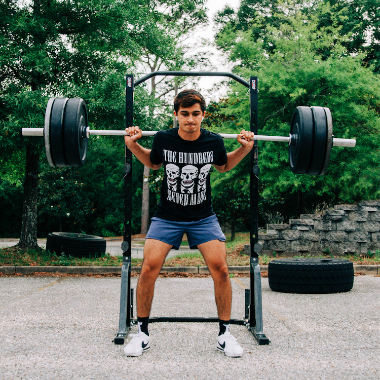 Personal trainer Blaze squating 315lbs.